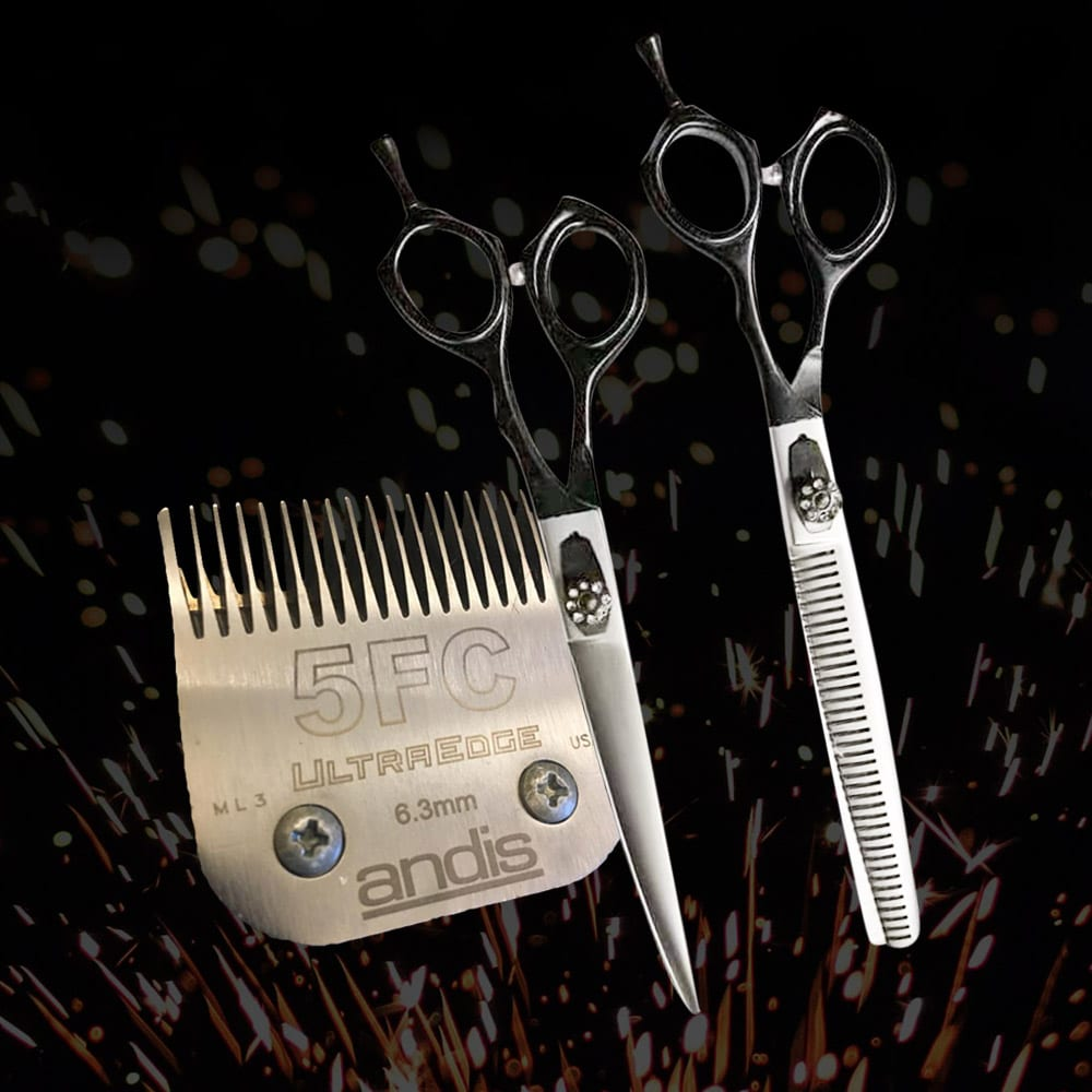 A set of dog grooming scissors and blades